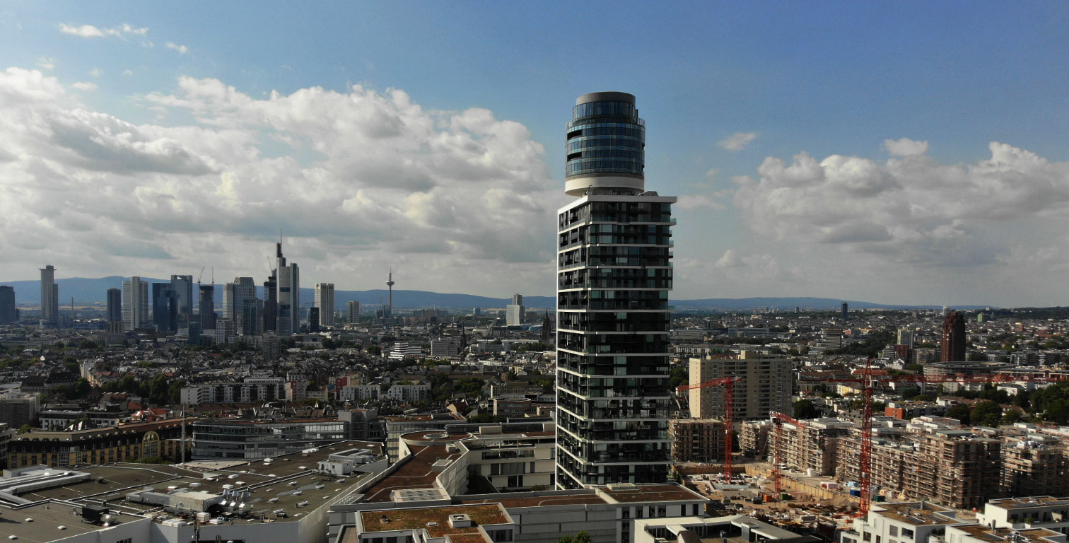 Henninger tower in Frankfurt - skyline in the background - panoramic view and restaurant Franzsika in the spire