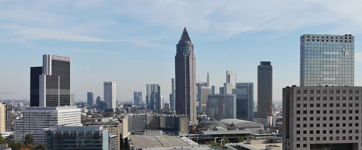 MesseTurm in Frankfurt - and the skyline of Frankfurt in the background - right: Messe Torhaus - left: Westend Gate skyscraper - Panorama of Frankfurt